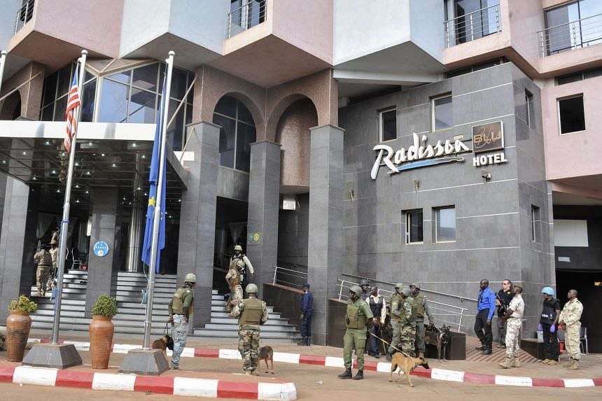 Security forces surrounding the Radisson Hotel during the hostage situation at Bamako, Mali on Nov 20, 2015.