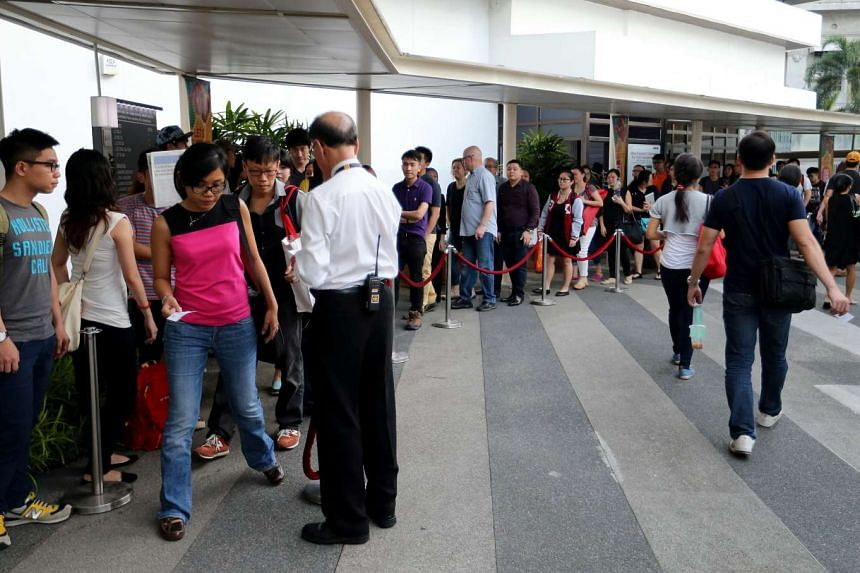 Around 70 people, a majority of them City Harvest Church members, were in the queue by 7.15am, when court passes were given out.