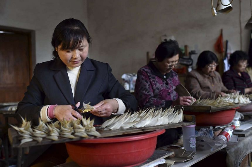 Workers making the heads of writing brushes at a workshop in Zhejiang province, China. The Chinese are moving from labour-intensive lower-cost production towards more of the higher-value inputs themselves, and that shift is having quite dramatic effects a
