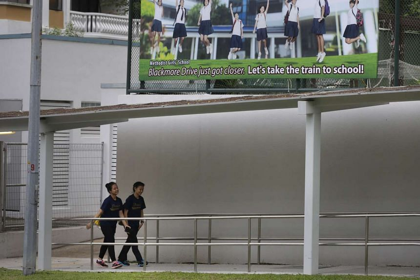 A banner encouraging students to take the MRT to commute to school is on display outside Methodist Girls' School.