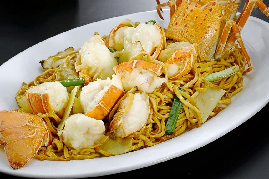 Lobster noodles with ginger and spring onion.