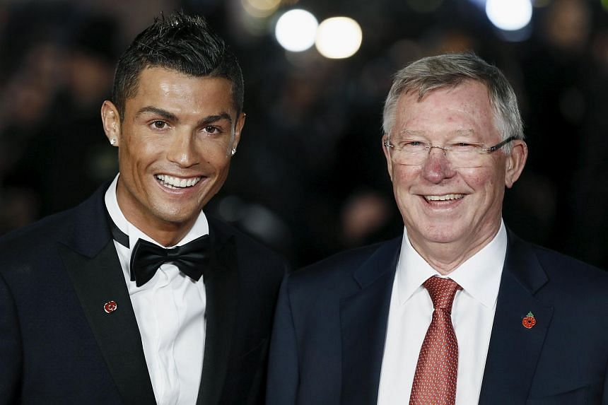 Cristiano Ronaldo (left) and Manchester United's former manager Alex Ferguson pose for photographers on the red carpet at the world premiere of the movie Ronaldo.