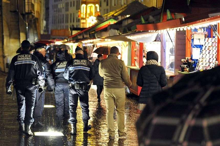 French policemen patrolling the Christmas market in Metz, eastern France, on Nov 21, 2015.