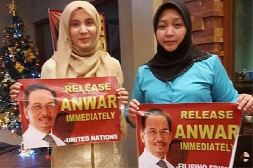 Malaysian opposition politician Nurul Izzah Anwar (left) may have committed an act of treason by meeting with an enemy of the state.