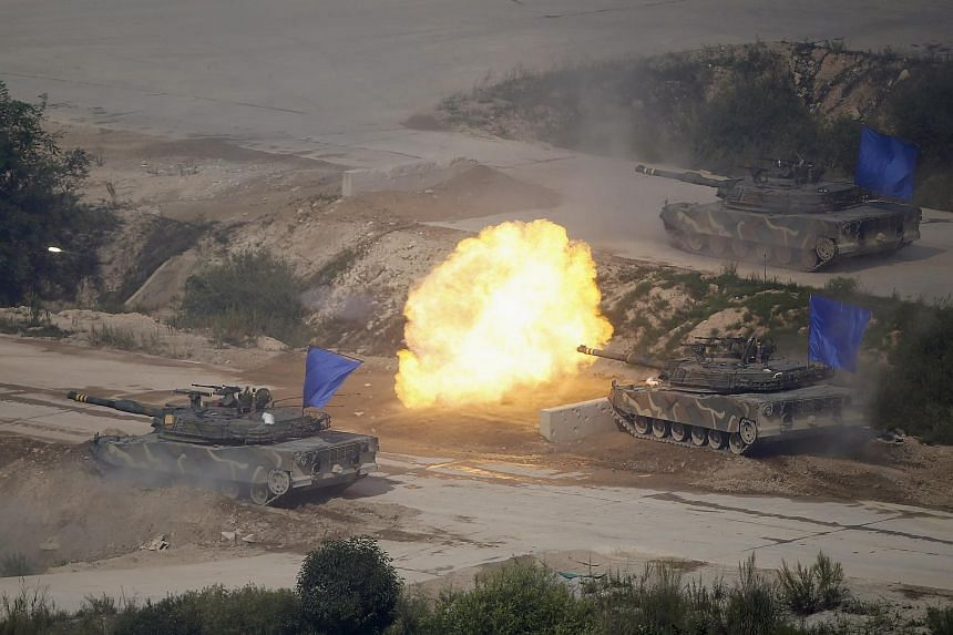 South Korean army K1A1 tanks fire live rounds during a US-South Korea joint live-fire military exercise.