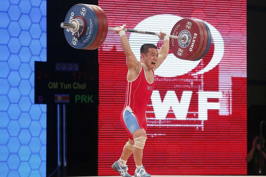 Om Yun Chol of North Korea sets the world record in the men's 56kg clean and jerk during the International Weightlifting Federation World Championships.