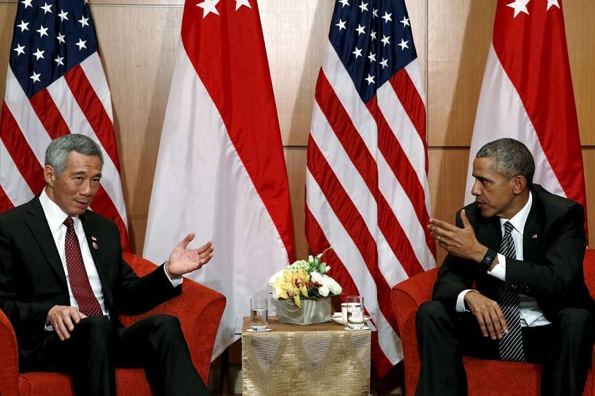 Prime Minister Lee Hsien Loong (left) speaking with US President Barack Obama after their bilateral meeting in Kuala Lumpur, on Nov 22, 2015.