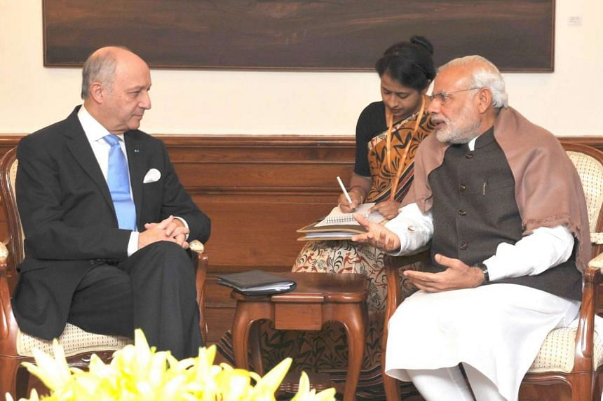 A handout photograph released by the Indian Press Information Bureau shows French Foreign Minister Laurent Fabius (left), during a meeting with the Indian Prime Minister Narendra Modi, in New Delhi, India, on Nov 20, 2015