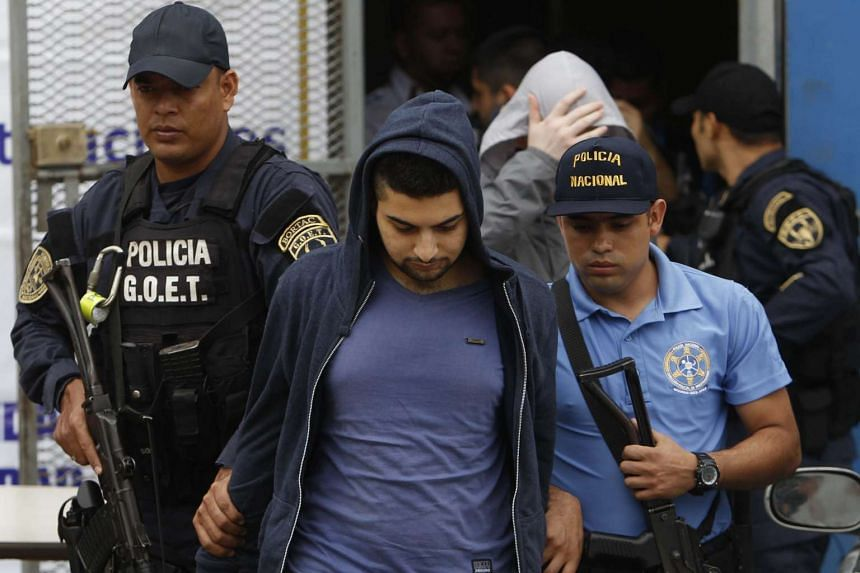 Honduran police escort a man of Syrian nationality who was arrested at the Toncontin international airport of Honduras, with false Greek passport trying to travel to United States in Toncontin, Honduras, on Nov 20, 2015.
