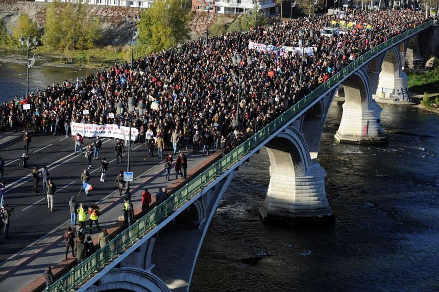 People take part in a silent walk to support freedom and peace and against barbarism and misconceptions in Toulouse on Nov 21, 2015, following Paris' Nov 13 terror attacks.