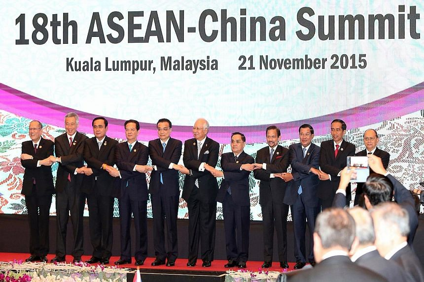 Locking hands in traditional Asean fashion at the Kuala Lumpur Convention Centre during the Asean-China Summit are (from left) Philippine President Benigno Aquino, Prime Minister Lee Hsien Loong, Thai Prime Minister Prayut Chan-o-cha, Vietnam Prime M
