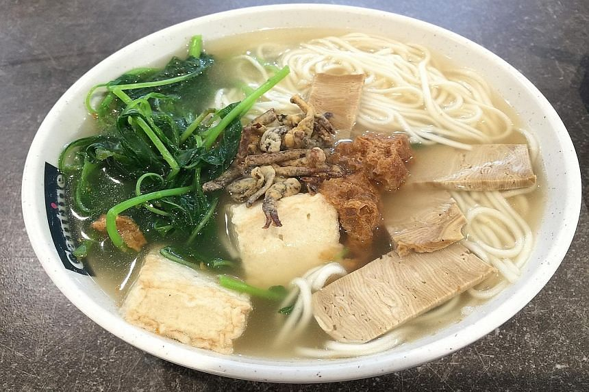 Xuan Miao Vegan's ban mian comes with a generous portion of spinach, vegetarian fish maw and mock meat slices topped with fried sliced mushrooms.