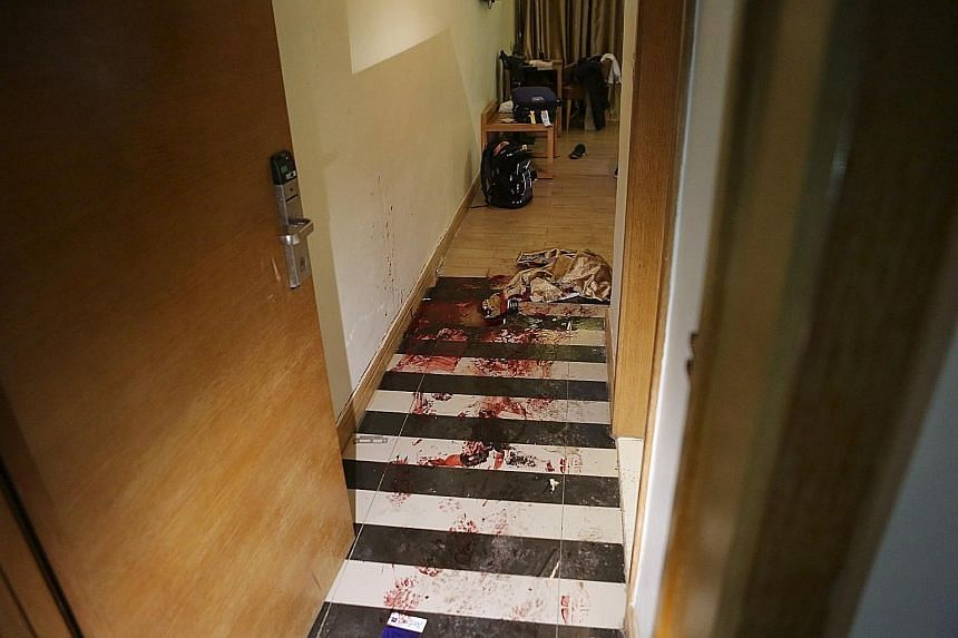Blood-soaked drapes (above) on the floor of the Radisson Blu Hotel in Bamako after Friday's terror attack. Police yesterday cordoned off the hotel (left). Investigators are hunting at least three suspects linked to the assault.