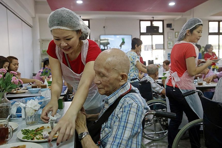 Finalists of Mrs Singapore World 2015 took on the role of hawkers for a day yesterday at Dignity Kitchen, Singapore's first hawker training school for disabled and disadvantaged people. Contestants, such as Ms Jean Koh, 44 (above), prepared lunch for