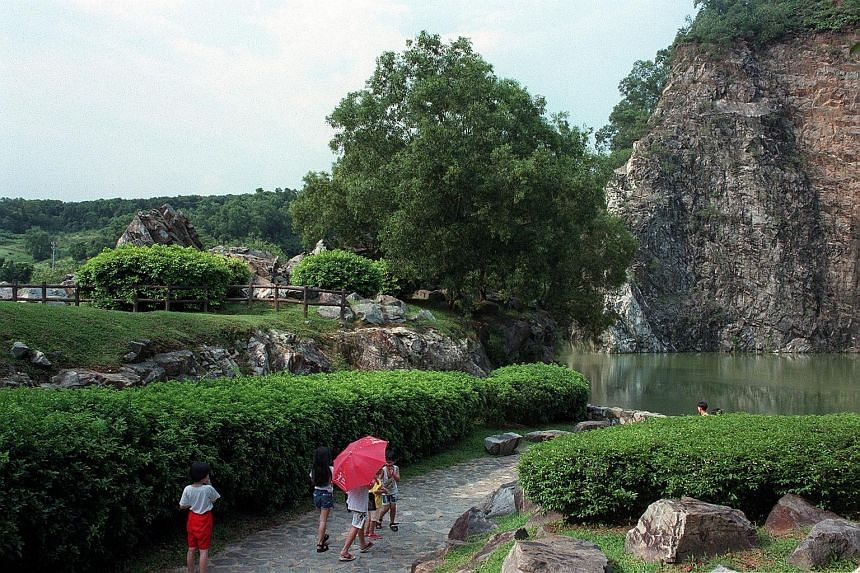 Some of Singapore's oldest rock formations can be found in Xiao Guilin (above). The park's wildlife also draws anglers and shutterbugs (left).