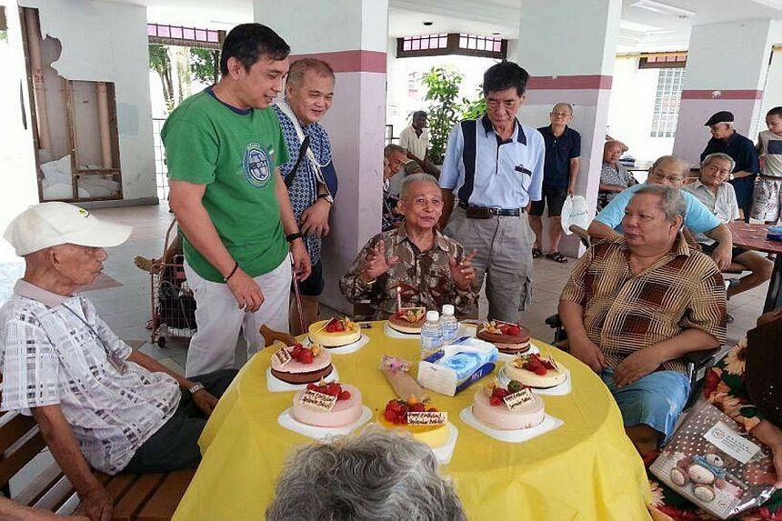 Mr Raymond Khoo (in green) at a birthday celebration for needy residents of Lengkok Bahru. Such joint events are held on the first Saturday of every month.