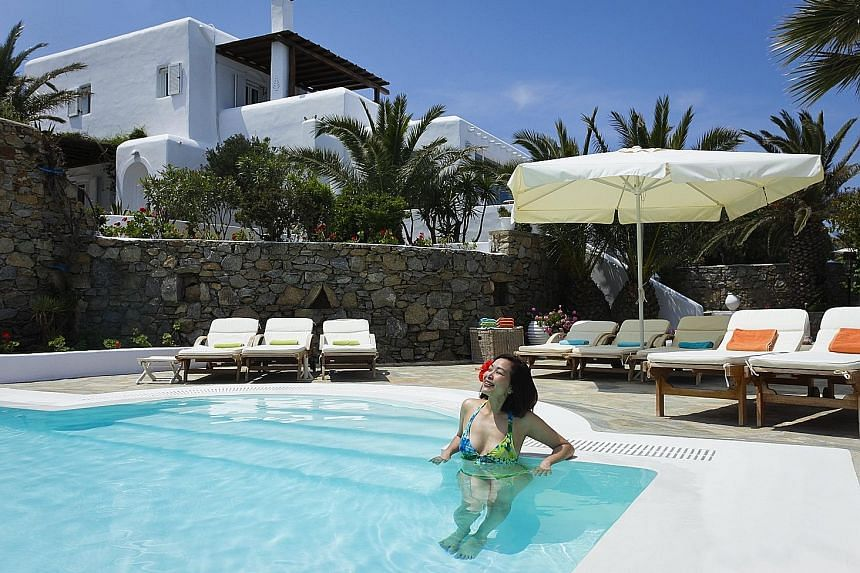 Villa Hurmuses on Mykonos offers views of traditional white-washed villages.