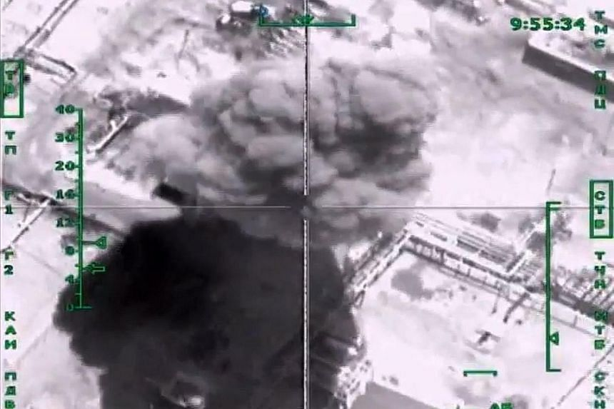 Video footage showing smoke from a bombed ISIS oil refinery in Syria targeted in a Russian air strike.