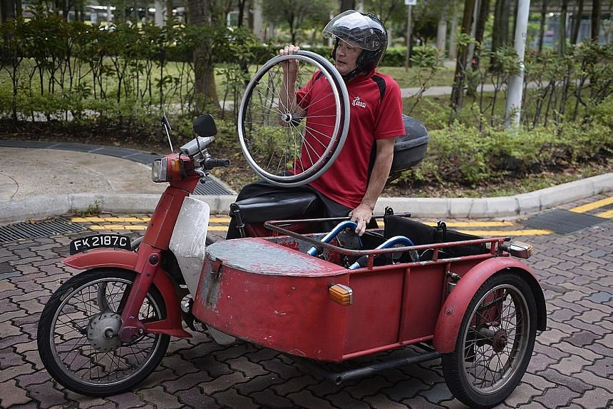 Jack Lai uses a modified motorbike to get to work. An attached sidecar stores his wheelchair which can be disassembled.