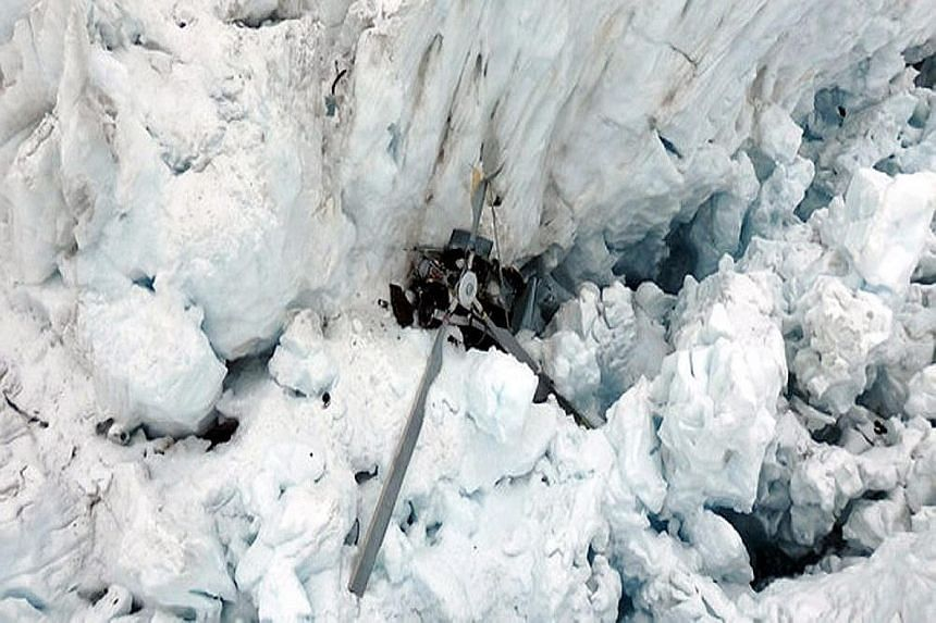 The sightseeing helicopter plunged into Fox Glacier during bad weather yesterday.