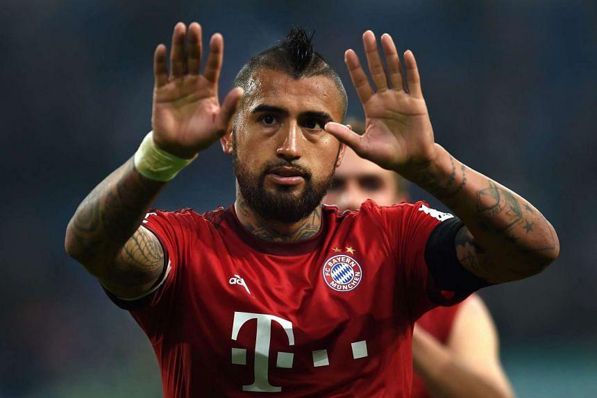 Bayern Munich's Chilean midfielder Arturo Vidal reacts after the match.