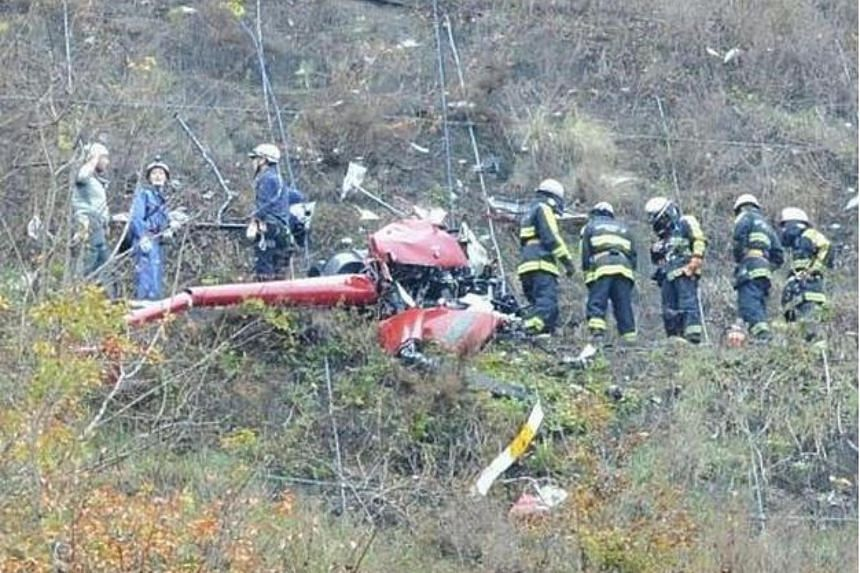 Rescue personnel working at the helicopter crash site in Annaka, Gunma prefecture, on Nov 22, 2015.