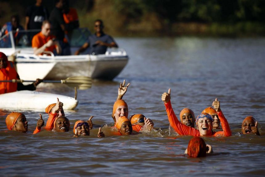 Sudanese and Dutch women take part in an event to swim across the Blue Nile.