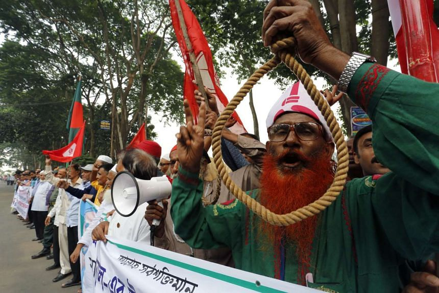 Protesters call for the death penalty to be upheld in Dhaka.
