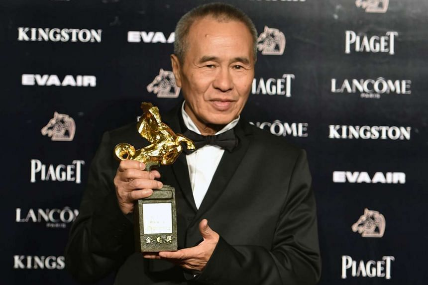 Taiwanese film director Hou Hsiao-hsien with his Best Director award.