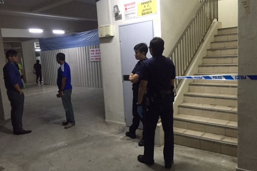 Police seen at the void deck in Yishun after a 76-year-old retiree died in his flat on Saturday night.