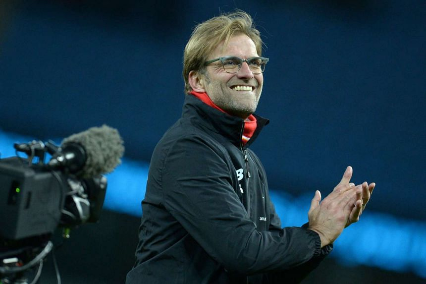Klopp gestures to supporters after the match.