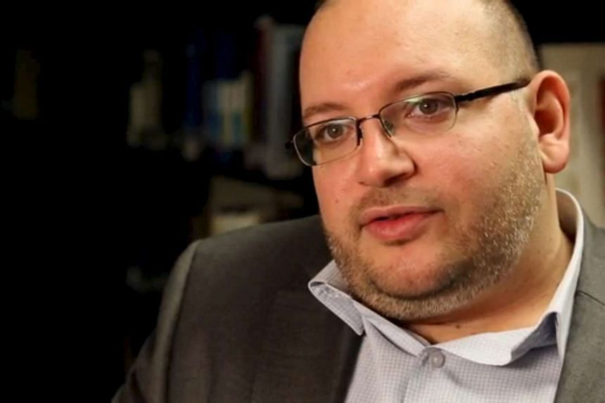 Washington Post reporter Jason Rezaian speaks in the newspaper's offices in 2013.