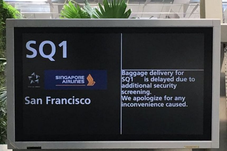 A sign informing passengers of Singapore Airlines flight SQ1 of a delay due to security screening, on Nov 22, 2015.