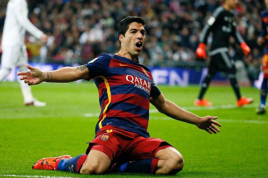 Barcelona's Uruguayan striker Luis Suarez celebrates after scoring the 0-4 lead against Real Madrid.