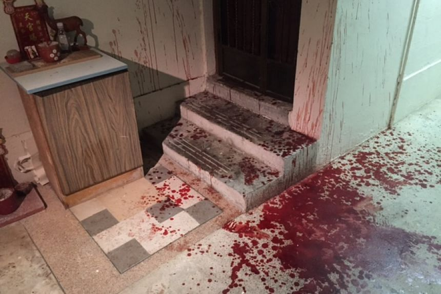 Blood spatters seen at a common corridor of a flat in Yishun.