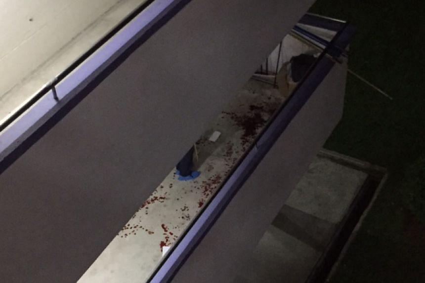 Blood spatters seen along a common corridor walkway in Yishun.