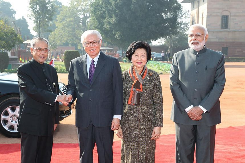 Indian President Pranab Mukherjee (left) welcoming Singapore President Tony Tan Keng Yam at the presidential palace in New Delhi on Feb 9, 2015. Indian Prime Minister Narendra Modi is on the right.