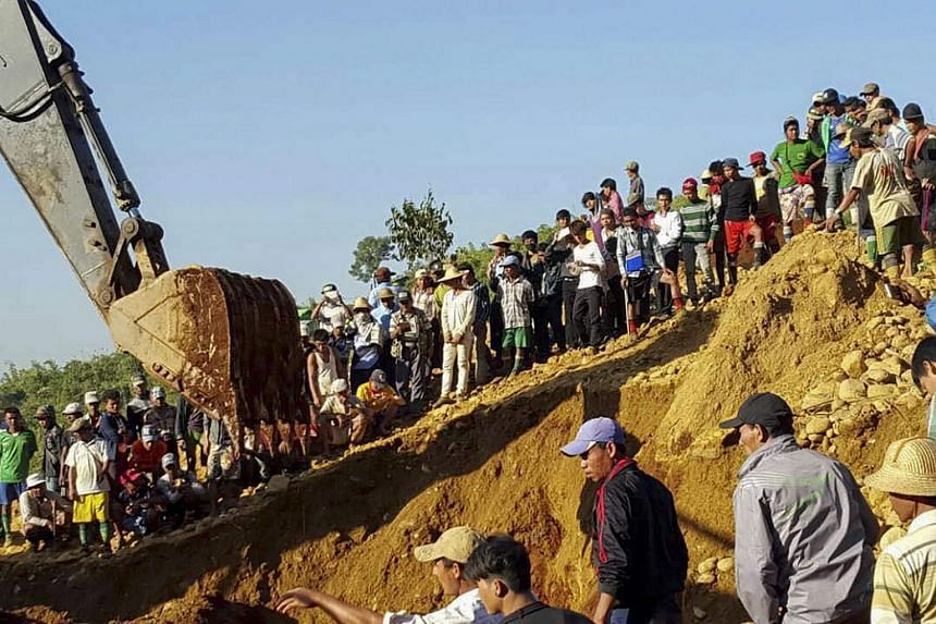 People searching for miners killed by a landslide at the Hpa Kant jade mining area in Kachin State, northern Myanmar.