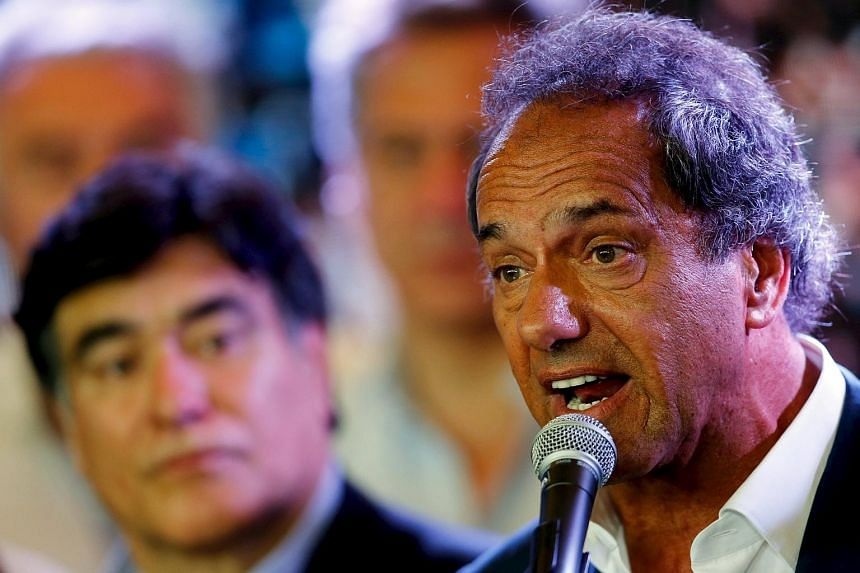 Argentina's ruling party presidential candidate Daniel Scioli (right) speaks during a news conference in Buenos Aires.