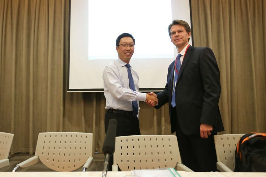 Mr Chew Men Leong (left), chief executive of LTA, shakes hands with Mr David Brown (right), group executive of Go-Ahead group.