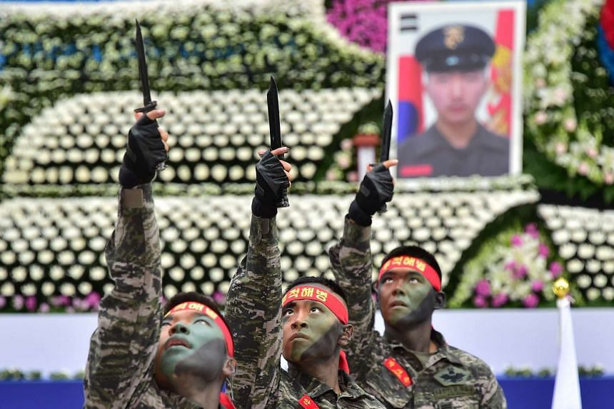South Korean marines perform a martial art during during a ceremony to commemorate the 5th anniversary of Pyeongyang's deadly shelling attack.