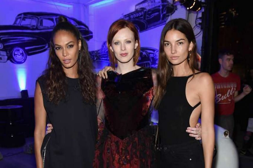 Karen Elson (centre) is the new face of Cartier in a Christmas campaign that channels old world glamour.