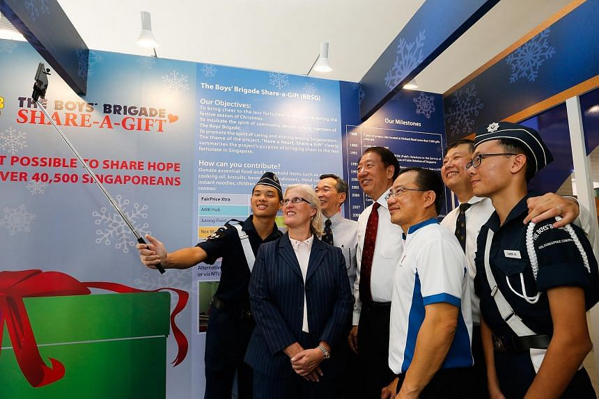 Deputy Prime Minister Teo Chee Hean taking a selfie at the launch of the Boys' Brigade's annual Share-a-Gift campaign.