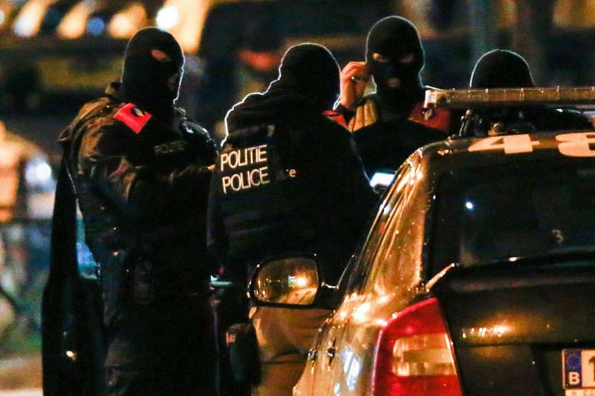 Belgian special police forces take part in an operation in the neighborhood of Molenbeek in Brussels, Belgium, Nov 22, 2015, after security was tightened in Belgium following the fatal attacks in Paris.