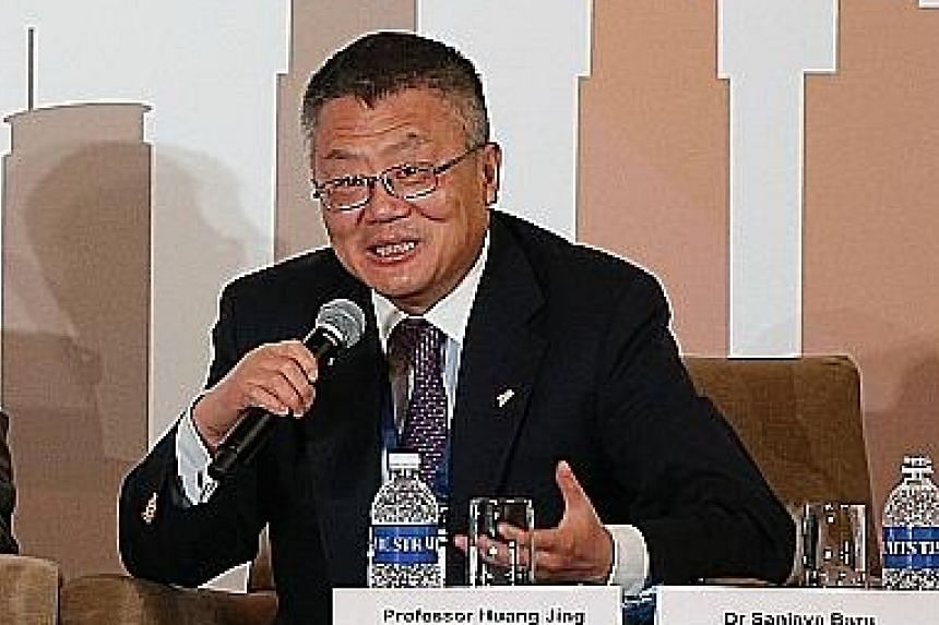 """Prof Huang Jing said: """"China has developed for 30 years without the rule of law... it has to restructure, redistribute resources, cut right into the privileged interest groups which established themselves during the rule of Jiang Zemin and Hu Jintao."""