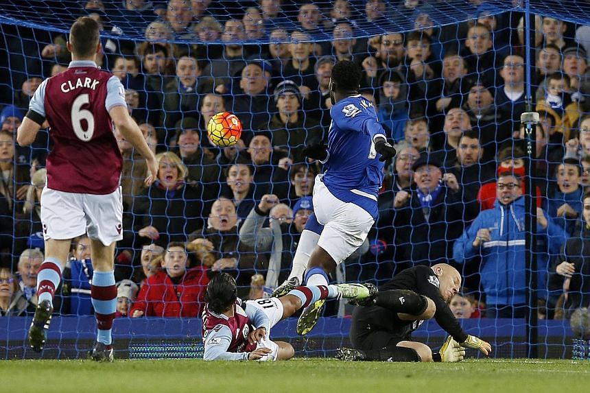 Striker Romelu Lukaku scores his second in Everton's 4-0 rout of Aston Villa on Saturday, underlining questions about their EPL tenure.