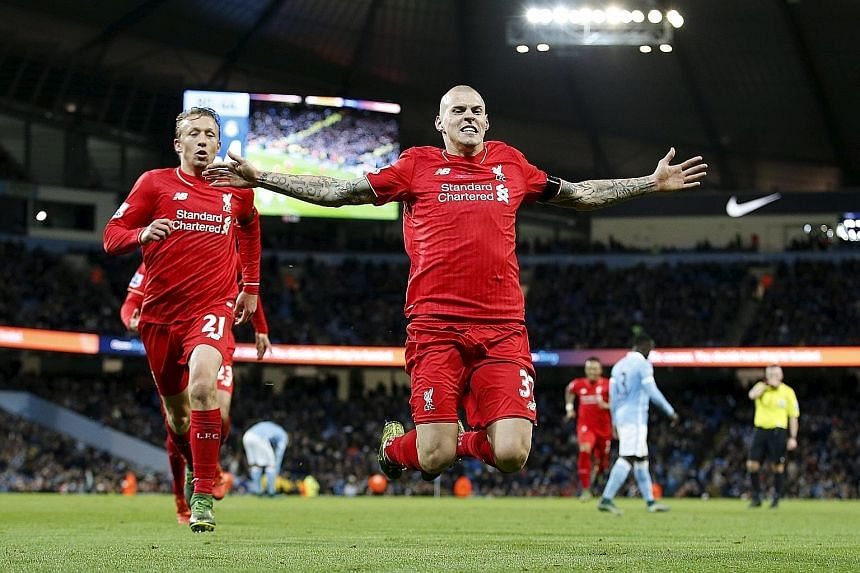 An airborne Martin Skrtel celebrating scoring the fourth goal for Liverpool in the 4-1 victory against Manchester City in their English Premier League encounter at Etihad Stadium on Saturday.