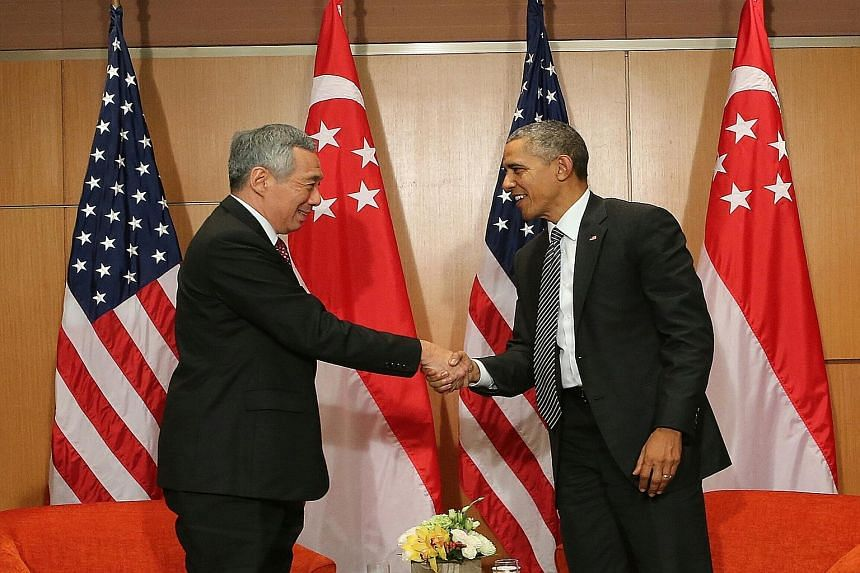 """Prime Minister Lee Hsien Loong and US President Barack Obama in Kuala Lumpur yesterday. Mr Obama said that around the world, """"people admire the incredible progress Singapore has made in creating prosperity and opportunity for its people and for being"""