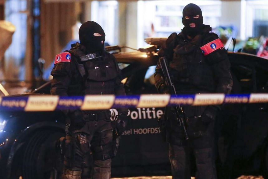 Belgian security forces during a police operation in Belgium's Molenbeek on Nov 22, 2015.