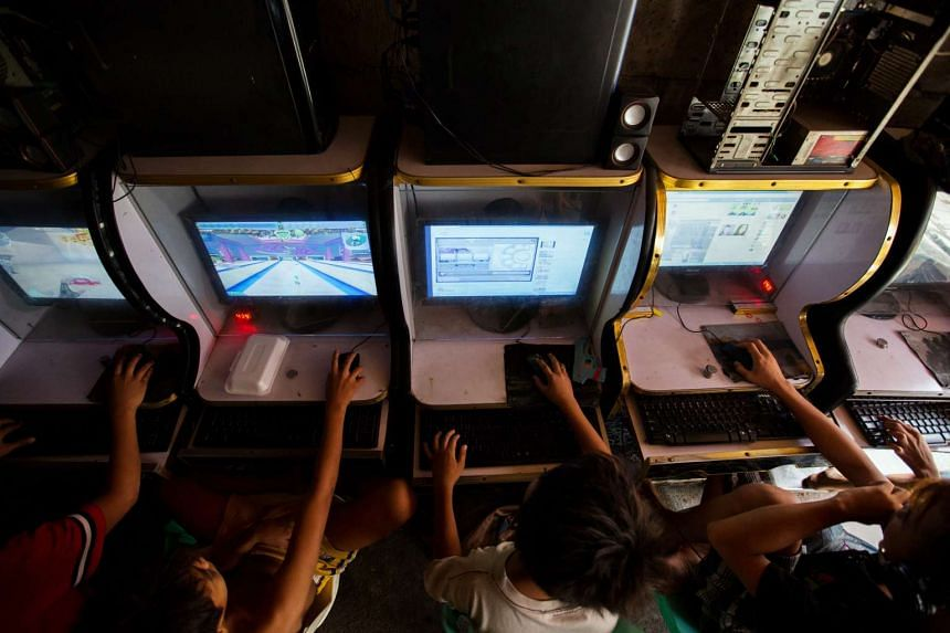 Children playing computer games in an Internet cafe.